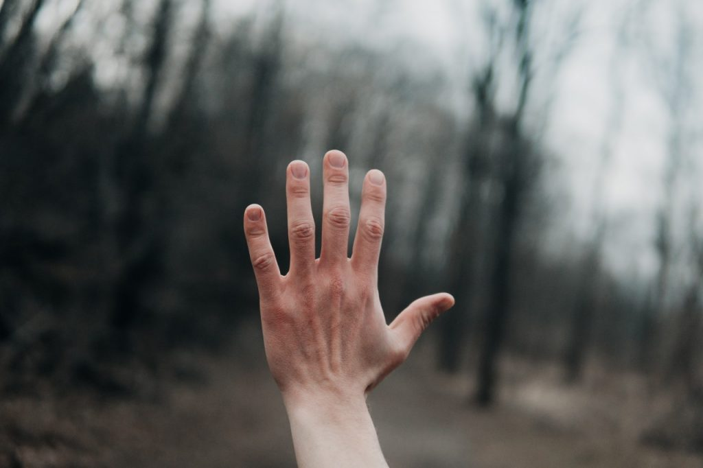 Hand outstretched on a winters day