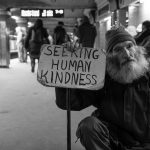 Homeless man holding