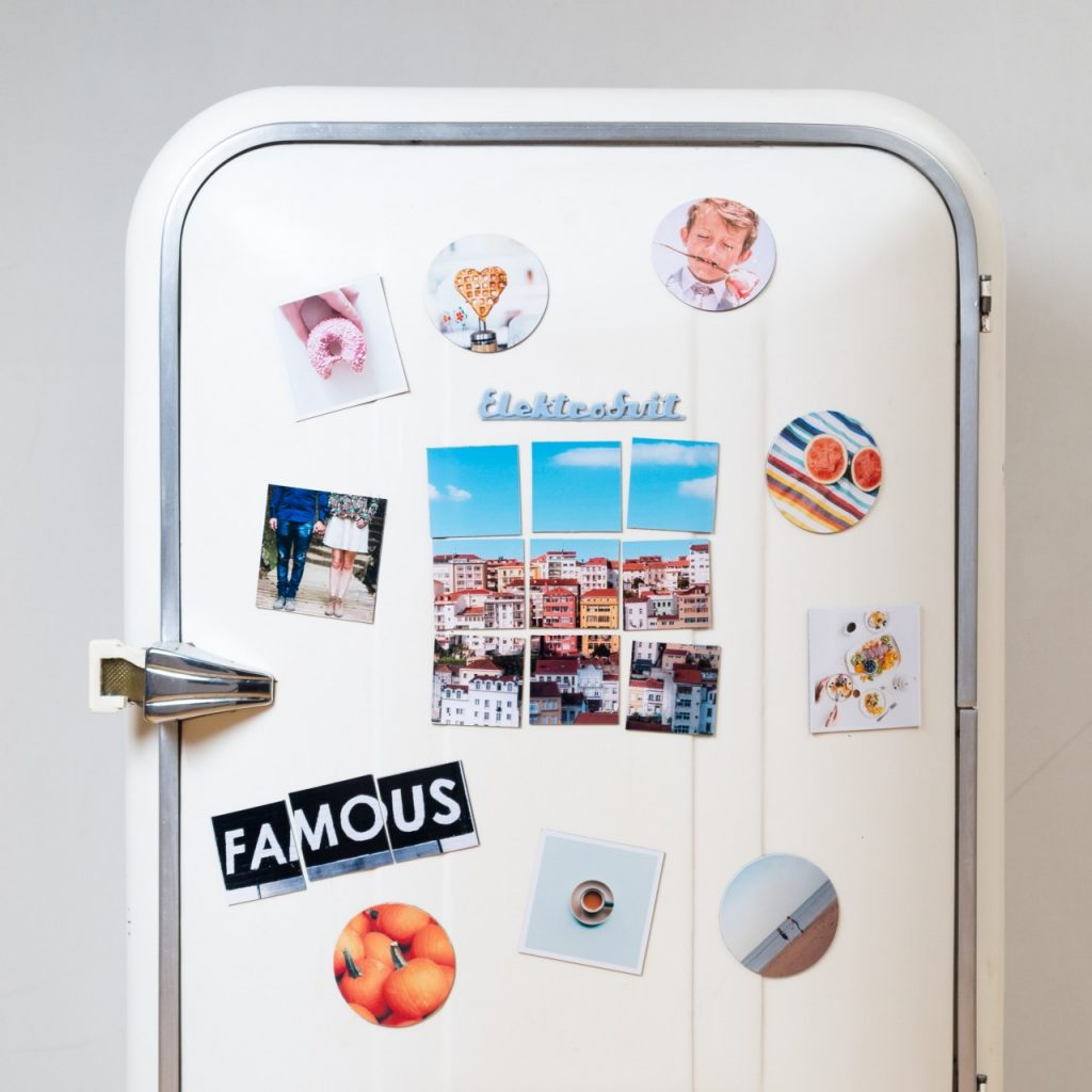 Fridge with magnets and photos on the front