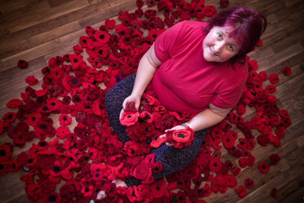 Rachel with just a small number of the poppies crafted by residents of Pennington