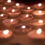 Candles lit during All Souls service
