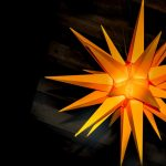 Orange lit star hung from ceiling