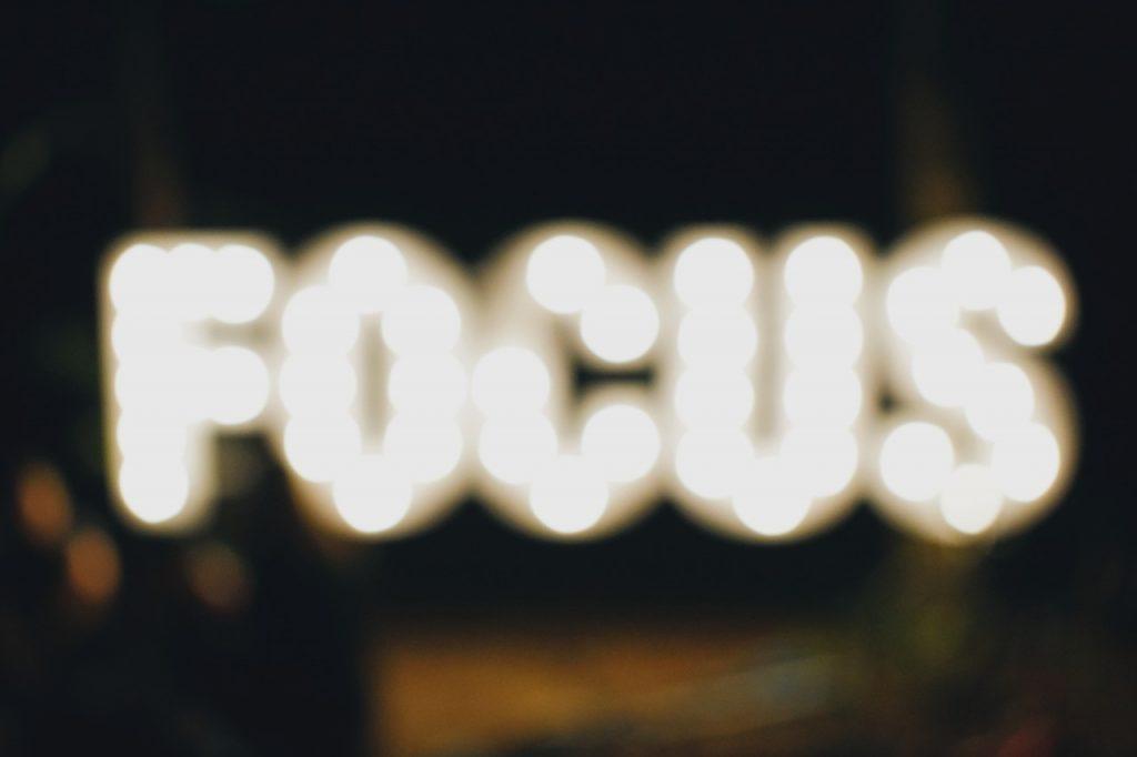Bokeh effect against lit sign 'Focus'