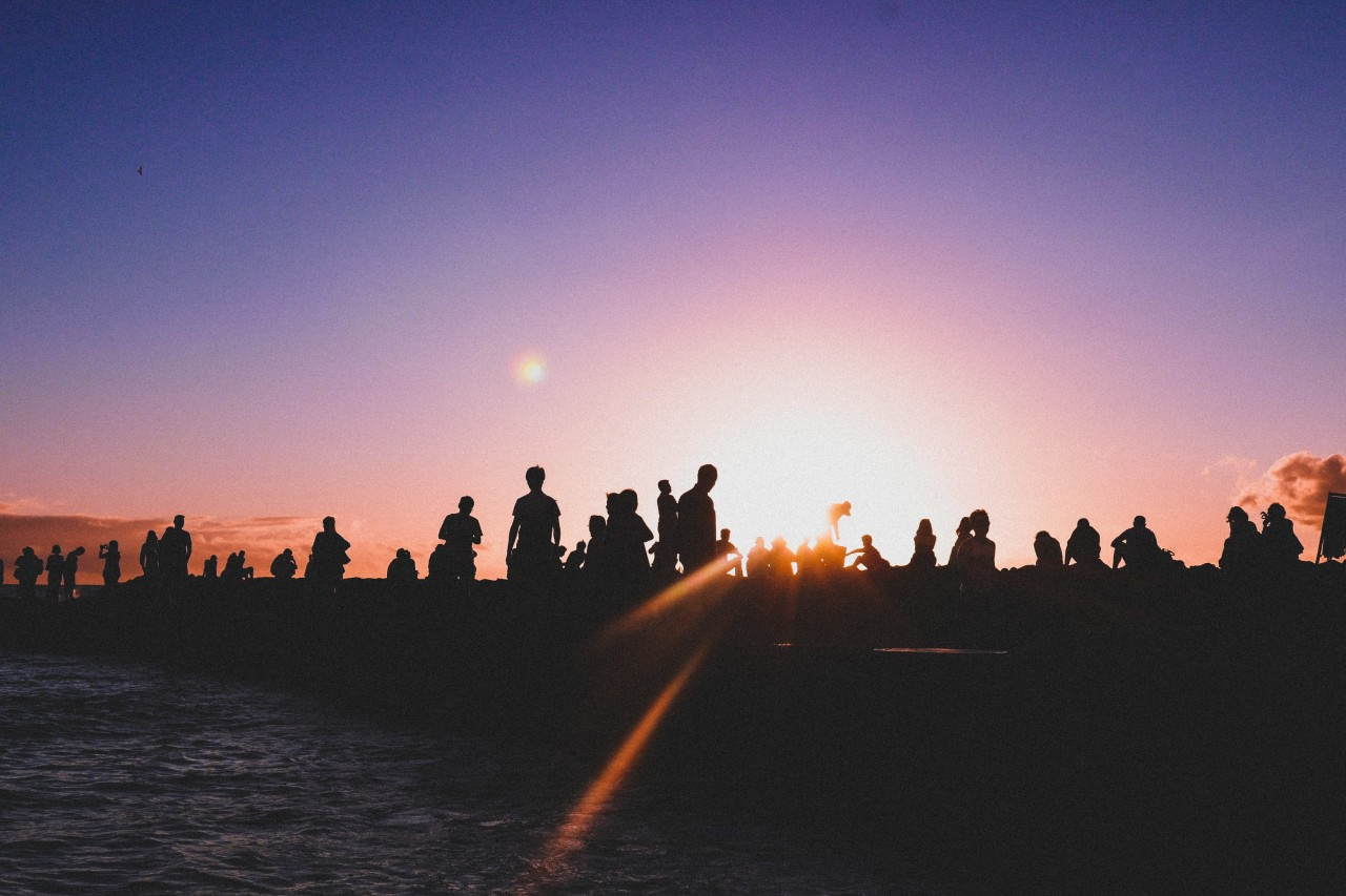 Group of people silhouette against sunrise