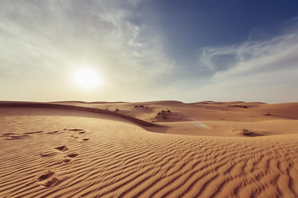 Desert sand with footprints