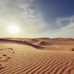 Desert sand with footprints
