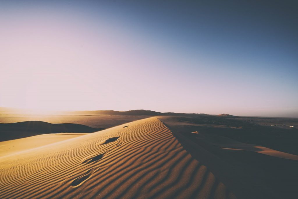 Footsteps in the sand dune